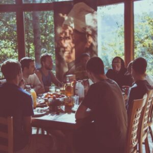 a group of people eating in a restaurant
